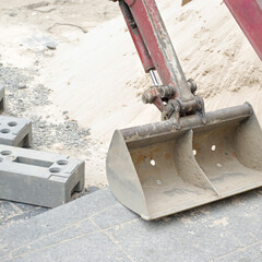 Small scoop of excavator at building site