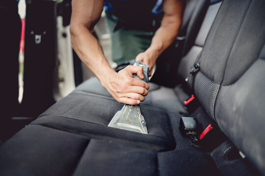 Close up details of car detailing - Cleaning and vacuuming car interior
