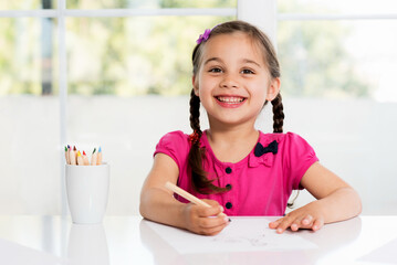 Happy Little Girl Drawing Picture