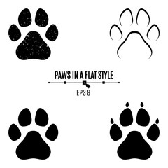 A set of dog's paws. Black traces in different styles. Isolated on white background. Silhouettes of paws
