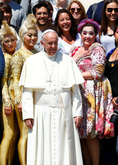 Pope Francis poses with members of Cirque du Soleil during his Wednesday general audience in Saint Peter's square at the Vatican