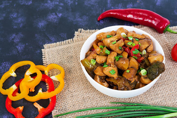 Stir Fry Chicken with peppers and mushrooms on dark background