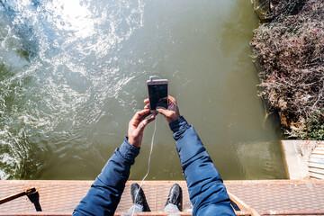 Crop shot of man taking selfie