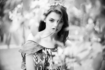 Sexy woman in stylish garden. Black and white photo