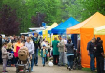 Blurred image of people on food market.