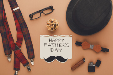 Happy Fathers Day card on cork texture background
