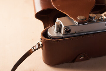 Old film camera on wooden background,