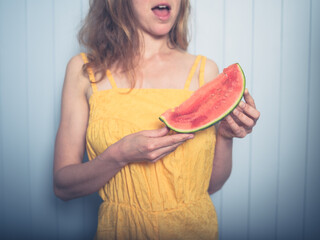 Young woman eating water melon