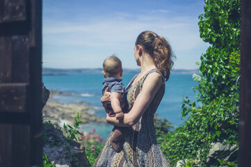 Young mother with bay by the sea