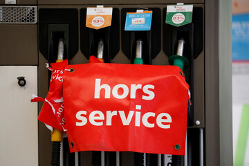 """A sign which reads """"Out of service"""" on fuel pumps indicates the petrol station has no gasoline or diesel as a strike continues by transporters of hazardous materials impacts fuel distribution across the country, in Paris"""