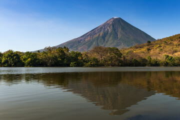View of the Concepcion Volcano and its reflection on the water in the Ometepe Island, Nicaragua; Concept for travel in Nicaragua and Central America