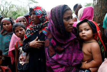 Rohingya refugees who are affected by Cyclone Mora, gather to collect relief supplies at Balukhali Makeshift Refugee Camp in Cox's Bazar