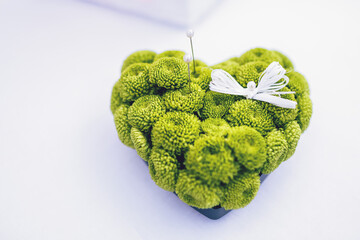 Pillow of greenery made in form of a heart