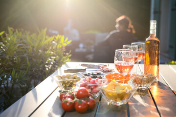 Foto op Plexiglas Buffet, Bar holiday summer brunch party table outdoor in a house backyard with appetizer, glass of rosé wine, fresh drink and organic vegetables