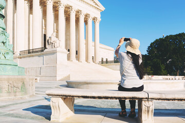 Woman taking a photo of the Supreme Court of the United States