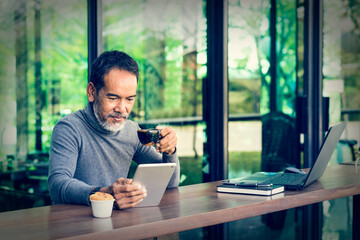 Portrait Smiling Attractive mature man with white stylish short beard using smartphone. Serving internet via his gadget. Old man using social network technology