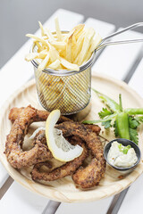 fried octpus rings calamari style with fries snack set