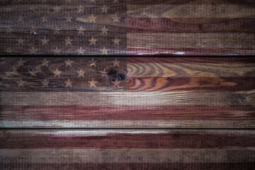 Vintage American Flag painted on an aged, weathered rustic wooden Background.