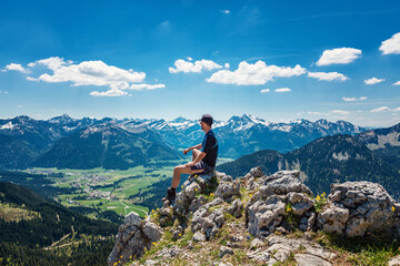 Man Enjoying View of Mountains in Allgau Alps Wall mural