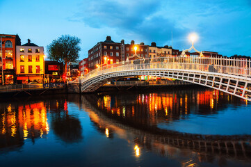 Dublin, Ireland. Night view of famous illuminated Ha Penny Bridge