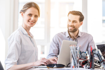 Charming engineer female working in office