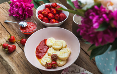 Dumplings from rice flour and cottage cheese with a pitted strawberry