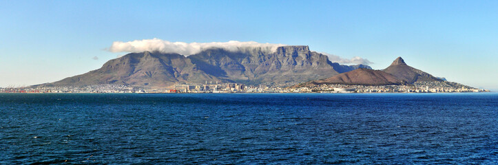 Cape Town, South Africa May 20, 2016: Cape Town and coast line, jetty. Far mountain on the blue sky background. Summer. South Africa