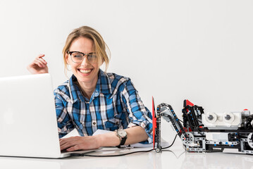 Joyful young engineer female satisfied with her work