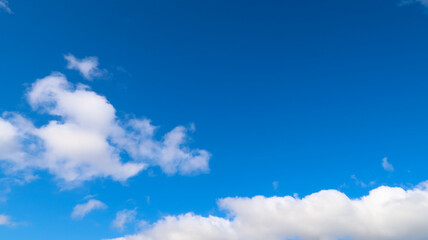 Fluffy White Clouds in Blue Skies