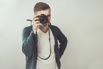 Attractive Man Photographer Standing and Shooting With a Dslr Camera