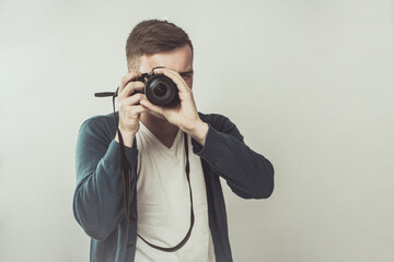 Handsome Young Man Photographer Aiming With the Camera.