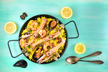 Spanish seafood paella with lemons and copyspace