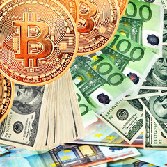 Golden Bitcoins close-up.Euro and dollars currency as a background. Photo (new virtual money ) .Conceptual photo.
