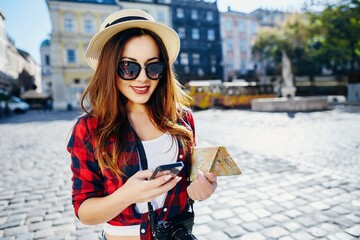 Cute tourist girl at European city background