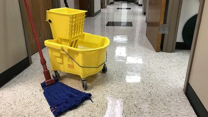 Janitors mopping bucket and mop