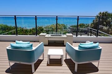 Inviting outdoor terrace with designer furniture overlooking the ocean.