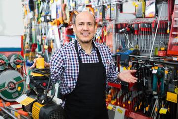 salesman offering modern electric pump