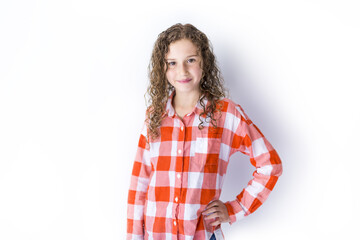 Portrait of 9 years old girl with curly hair, isolated on white