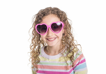 Portrait of happy, smiling, confident 9 years old girl with curly hair, isolated on white