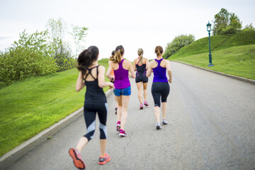 group of people enjoying in the fitness having fun running outside