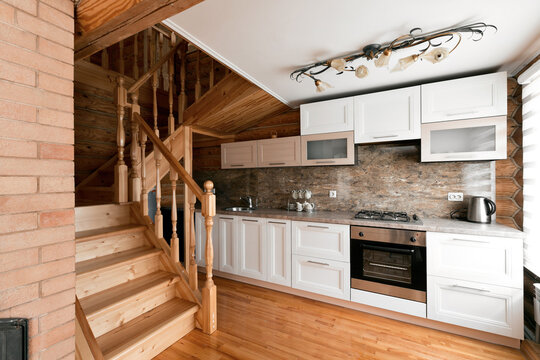The kitchen room in a rustic log cabin, in the mountains. with a beautiful interior. house of pine logs