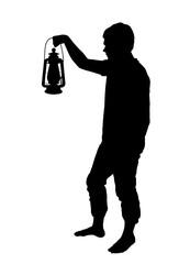 Silhouette of teenage boy holding up lantern