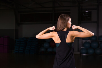 Female bodybuilder's muscular back flexing