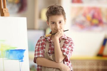 Cute little artist in studio