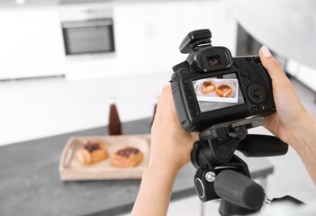 Young woman photographing food in photo studio, closeup