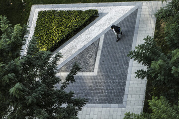 Aerial view of geometrical shapes of  garden and gravel path, in Xian, China, with unidentified stroller