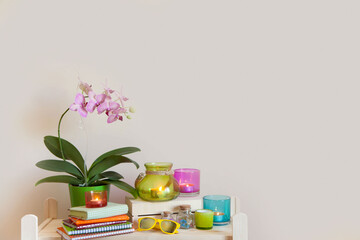Colored candles, orchid and bright decorative elements of the interior.