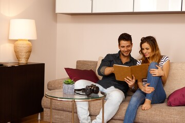 Young couple using tablet at home