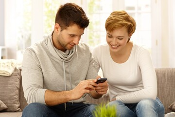 Young couple using mobile