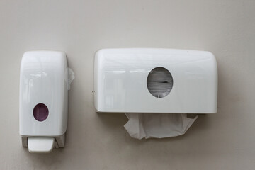 Bathroom tissue or toilet paper hanging white box on the wall.